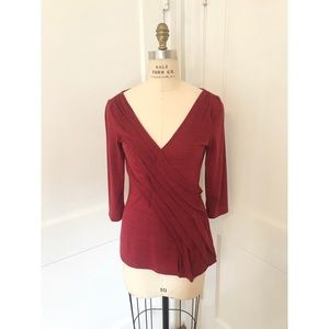 Red Anthropologie tee with pleated detail